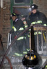 2-11 alarm at 1915 S. Homan 1/11/09  (l-r) Lt. Mo Demus (T48) Billy Meyer (E38), Chuck Miller (T48)