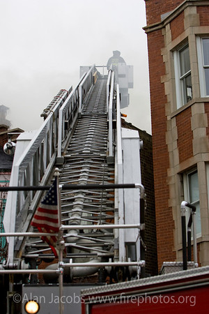 A tower ladder is raised and then extended as much as eight stories.