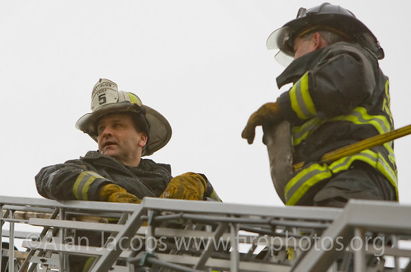 Battalion Chief Keith Witt on the ladder