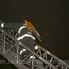 Fireman Eric Troken to the roof.