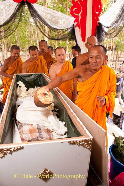 Monk Pours Coconut Water On Corpse