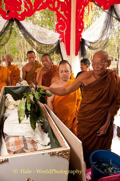 Buddhist Monk Pours Coconut Water On Corpse
