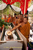 Theravada Buddhist Monk Pours Coconut Water On Corpse