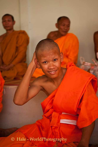 Novice Monk Cooling Off During Funeral Ritual