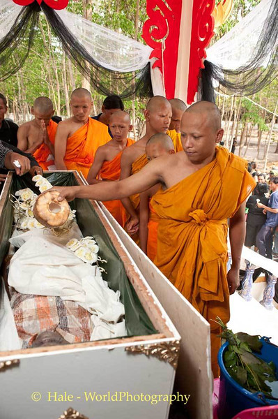 Novice Monk Pours Coconut Water On Corpse