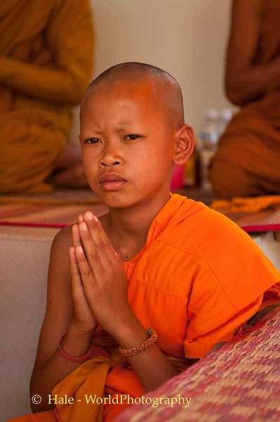 A Young Novice Monk Participates In The Ritual At Relative's Funeral