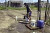 Uruguay : Asentamiento COTRAVI,ubicado en la zona oeste de la ciudad,un joven se abastece de agua potable  / Uruguay: drinking water.  poverty / Uruguay: Armut. Trinkwasser. <br /> © Sandro Pereyra/LATINPHOTO.org