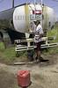 Uruguay : Asentamiento COTRAVI,ubicado en la zona oeste de la ciudad,un joven se abastece de agua potable,en una cisterna  / Uruguay: drinking water.  poverty / Uruguay: Armut. Trinkwasser. Wassertank.<br /> © Sandro Pereyra/LATINPHOTO.org