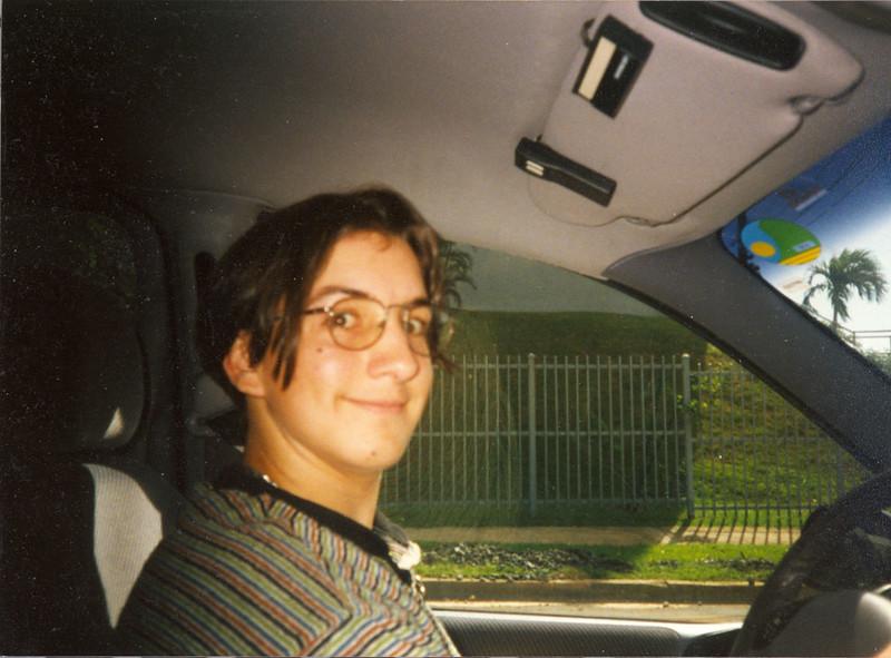 Dan looks goofy driving the now deceased BLUE Caravan