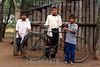 Paraguay : Ninos indigenas al costado de su casa . Comunidad NEPOXEN del chaco paraguayo. bicicleta. / Paraguay : indigenous. children. / Paraguay : Indigene ethnische Bevölkerung im Chaco. Kinder. Jungen mit einem Fahrrad. Velo.<br /> ©  Amadeo Velazquez/LATINPHOTO.org