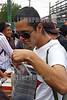 """Mexico - Mexico DF . 2007.08.11. Joven intercambia CDs en el Mercado (Tianguis) Cultural del Chopo. Cada sabado , cientos de jovenes acuden al Tianguis del Chopo . /  The Cultutral Market """"El Chopo"""". / Mexiko: Jugendliche besuchen den Markt El Chopo. ©  Ernesto Mendez/LATINPHOTO.org"""