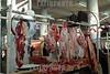 Paraguay : venta de carnes en puesto en el Mercado N∫4 . carne. carnicero. / Paraguay : Market Number 4. shop. sell. economy. vendor. butcher. meat. / Paraguay : Metzger.  Frau .Fleisch.<br /> © Martin Crespo/LATINPHOTO.org