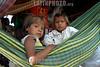 Brasil: ninos deni . Amazonas. hamaca. / Brazil: children. Deni tribe indians. indigenous. ethnic minority. autochthons. women. mothers. / Brasilien : Indigenes Kindde der Deni - Indianer. Urbewohner. Ethnische Minderheit im Amazonas - Gebiet. Hängematte. Indigene Bevölkerung.<br /> ©  Angelo Lucas/LATINPHOTO.org
