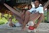 Brasil-Amazonia:  Miembros de la tribu Deni en el Rio Amazonas , Agosto 2003 .  Familias. Ninos. Chicos. Hombre. Hamaca. /Brazil-Amazonia: Indigenous from the Deni tribe at Amazonas River, August 2003. Beach. Sand. Man. Houses. Huts.  Hammock.  / Brasilien :   Eingeboren am Amazonas Fluss. (DIGITAL IMAGE) <br /> © Angelo Lucas/LATINPHOTO.org