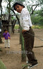 Paraguay : Nino indigena trepado al alambrado de su casa . Comunidad NEPOXEN del chaco paraguayo. / Paraguay : indigenous. children. Community of Nepoxen in the paraguayan Chaco. Child climbed to his house's fence. / Paraguay : Indigene ethnische Bevölkerung im Chaco. Kinder.<br /> ©  Amadeo Velazquez/LATINPHOTO.org