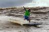 """Brasil : Surfista brasileno Sandro Burgelo pega una ola de la marea, conocido como pororoca, en el rio Araguari, en el estado norteno de Amapa, Brasil. La pororoca de Araguari es posiblemente el mas peligroso de todos los ondas de marea de la amazonia, temido por los residentes locales para el estrago que causa. Las ondas llegan a la altura de en 2 a 3 metros y alcanza velocidades entre 30 a 50 kilometros por hora. Para cogerlo, las surfista deben saltar de una lancha quando la onda sube el rio. Puesto que la onda ocurre solamente dos veces por el dia, cuando la marea entrante del oceano invierte el flujo del rio, no hay muchas ocasiones de cogerlo. La palabra """"pororoca"""" viene de las palabras de dialecto de las indigenas amazonenses """"poroc poroc"""" que significa  """"destructor"""" o """"gran rafaga"""" Desde el tiempo inmemorial, la gente ha temido el rugido que precede. / Brazil: Brazilian surfer Adilton Mariano surfs on the tidal bore wave, known as pororoca, on the Araguari River, in Brazil's northern state of Amapa. The Araguari pororoca is possibly the most dangerous of all the Amazonian tidal bores, long feared by locals for wreaking havoc on their communities. wave crests at 2 to 3 meters and races at speeds between 30 to 50 kilometers per hour.  To catch it, surfers must leap from a motorboat as the wave barrels upriver. Since the wave only occurs twice per day when the incoming ocean tide reverses the river flow for a time, there are not many chances to catch it,  The name """"pororoca"""" comes from an Amazonian indigenous dialect meaning """"destroyer"""" or """"great blast.""""  Since time immemorial, people have feared the roar which precedes the wall of water that capsizes boats and washes away anything in its path. Now, however, the people are less fearful and have begun to see the wave as a potential tourist attraction that could generate money in of one of the poorest states of Brazil. / Brasilien: Surfer in der Region von Pororoca. Abenteuer. © Douglas Engle/LATINPHOTO.org"""