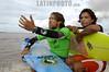 """Brasil : Surfista brasileno Sergio Laus grita a amigos quienes pegan una ola de la marea, conocido como pororoca, en el rio Araguari, en el estado norteno de Amapa, Brasil. Marcelo Vaia, derecha, lo acompana. La pororoca de Araguari es posiblemente el mas peligroso de todos los ondas de marea de la amazonia, temido por los residentes locales para el estrago que causa. Las ondas llegan a la altura de en 2 a 3 metros y alcanza velocidades entre 30 a 50 kilometros por hora. Para cogerlo, las surfista deben saltar de una lancha quando la onda sube el rio. Puesto que la onda ocurre solamente dos veces por el dia, cuando la marea entrante del oceano invierte el flujo del rio, no hay muchas ocasiones de cogerlo. La palabra """"pororoca"""" viene de las palabras de dialecto de las indigenas amazonenses """"poroc poroc"""" que significa  """"destructor"""" o """"gran rafaga"""" Desde el tiempo inmemorial, la gente ha temido el rugido que precede. / Brazil: Brazilian surfer Sergio Laus, left, shouts to fellow surfers on the tidal bore wave, known as pororoca, on the Araguari River. Marcelo Vaia is at right. The Araguari pororoca is possibly the most dangerous of all the Amazonian tidal bores, long feared by locals for wreaking havoc on their communities. wave crests at 2 to 3 meters and races at speeds between 30 to 50 kilometers per hour.  To catch it, surfers must leap from a motorboat as the wave barrels upriver. Since the wave only occurs twice per day when the incoming ocean tide reverses the river flow for a time, there are not many chances to catch it,  The name """"pororoca"""" comes from an Amazonian indigenous dialect meaning """"destroyer"""" or """"great blast.""""  Since time immemorial, people have feared the roar which precedes the wall of water that capsizes boats and washes away anything in its path. / Brasilien: Surfer in der Region von Pororoca. Abenteuer. © Douglas Engle/LATINPHOTO.org"""