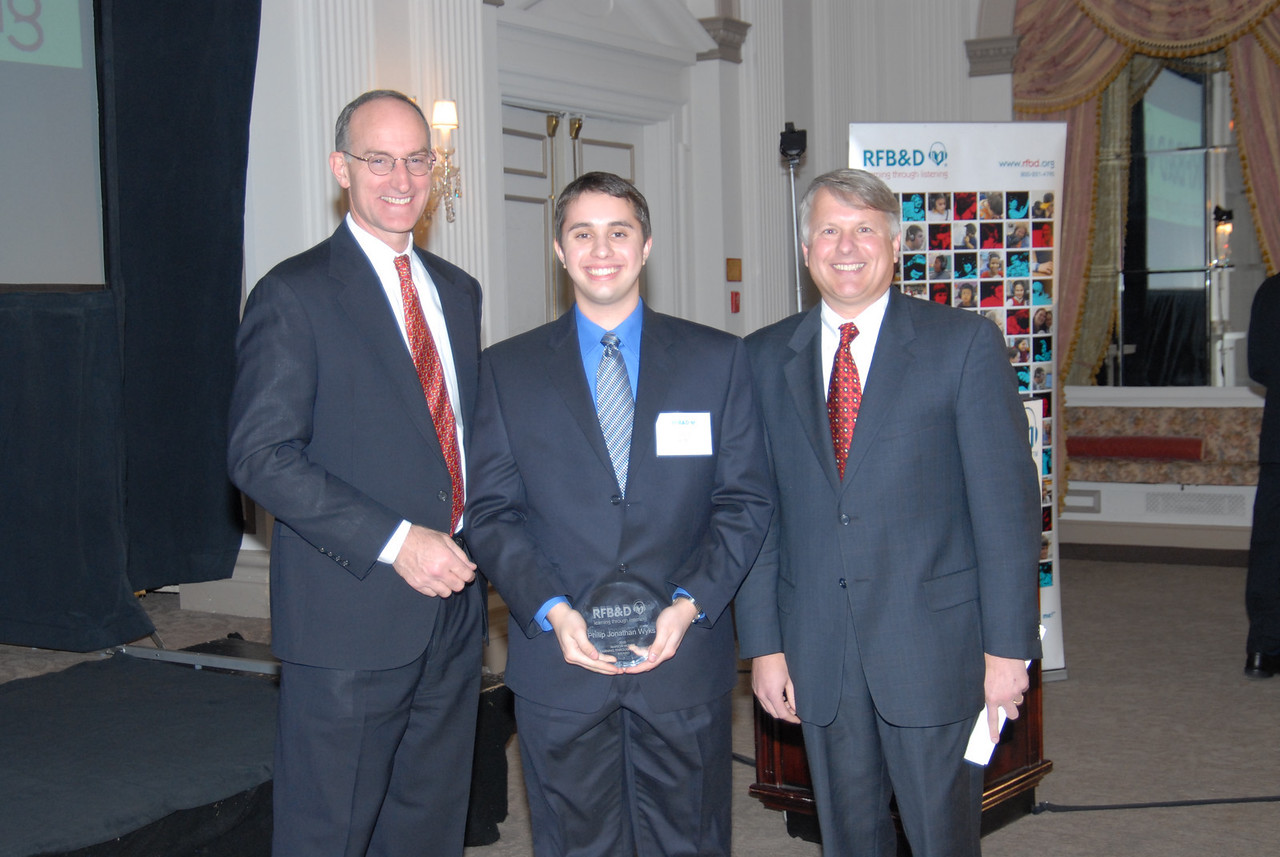 """Philip Wyks<br /> <br /> RIVER DELL REGIONAL HIGH SCHOOL GRADUATE HONORED AS 2005 NATIONAL ACHIEVEMENT AWARD WINNER BY RECORDING FOR THE BLIND & DYSLEXIC®<br /> Oradell, NJ, resident is recognized at national nonprofit's awards celebration in Washington, DC<br /> <br /> February 10, 2006 (Washington, DC) – Philip Wyks' struggle with dyslexia and dysgraphia was so severe, he recalls getting """"…so mad at my homework that I would throw my pillow down and hit it with a hammer."""" Despite those obstacles, the Oradell, NJ, teenager persevered and graduated high school with a 90 grade average. For that, and his extraordinary scholarship, leadership, enterprise and service to others, Wyks was honored by Recording for the Blind & Dyslexic (RFB&D®) as one of three top winners of the 2005 Marion Huber Learning Through Listening® (LTL®)awards. RFB&D, a nonprofit organization, is the nation's educational library of recorded textbooks for students with visual impairment, dyslexia or other physical disabilities that make reading standard textbooks difficult or impossible. <br /> <br /> Wyks told the gathering in Washington, DC, that RFB&D has been instrumental in his educational success. """"It is such a simple concept – reading out loud, but for people like me who need it, RFB&D becomes very powerful. We can not only survive, but stay competitive and succeed thanks to RFB&D.""""<br /> <br /> Diagnosed with dyslexia in the second grade, Wyks had difficulty taking notes and paying attention in class. """"Everyone around me was doing better than me,"""" he said. """"I was sometimes made fun of by the other kids because I couldn't read some of the words in our books."""" After being taught about the school newspaper in his high school journalism class, Wyks went home and told his mother that he could write anything he wanted, but that obesity wasn't allowed. Confused, his mother looked at his paper and replied, """"Philip, the word is obscenity."""" <br /> <br /> According to Wyks, his life turned around after"""