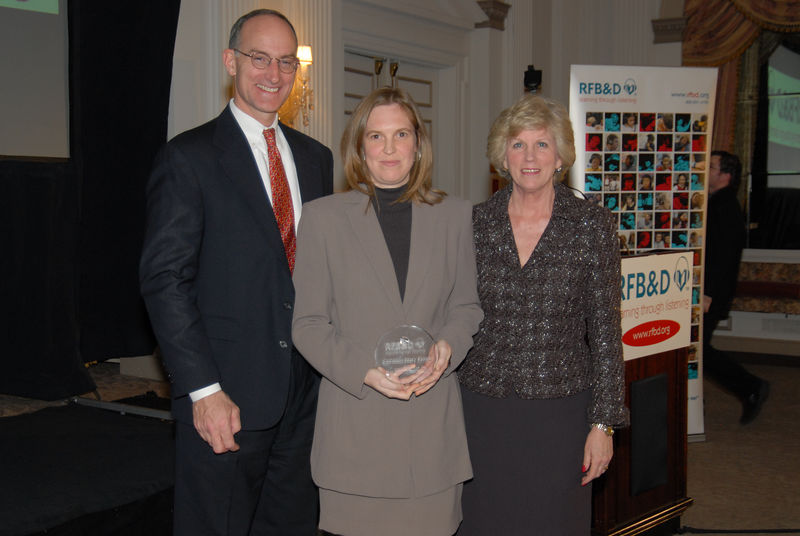"Kathleen Ernst<br /> <br /> UNIVERSITY OF GEORGIA GRADUATE HONORED AS 2005 NATIONAL ACHIEVEMENT AWARD WINNER BY RECORDING FOR THE BLIND & DYSLEXIC®<br /> Athens, GA, resident is recognized at national nonprofit's awards celebration in Washington, DC<br /> <br /> February 10, 2006 (Washington, DC) – Despite being visually impaired and 20 years older than the average college student, Kathleen Ernst graduated from the Terry College of Business at the University of Georgia last May. For that, and her extraordinary scholarship, leadership, enterprise and service to others, Ernst was honored by Recording for the Blind & Dyslexic (RFB&D®) as one of three top winners of the 2005 Mary P. Oenslager Scholastic Achievement Awards (SAAs). RFB&D, a nonprofit organization, is the nation's educational library of recorded textbooks for students with visual impairment, dyslexia or other physical disabilities that make reading standard textbooks difficult or impossible.<br /> <br /> Ernst told the gathering in Washington, DC, that ""RFB&D provides its users with a sense of empowerment that would otherwise not be there. In its place would be frustration and limitation. It is said that information is power, and RFB&D provides that power by making information accessible to those of us who need to use this alternative method of learning.""<br /> <br /> Diagnosed with Stargardt's Disease, a leading cause of central vision blindness, Ernst began to lose her vision at age 11 and recalls encountering many academic and personal challenges related to her visual limitations. ""With much support from family, friends and organizations such as RFB&D,"" she adds, ""I have successfully overcome them."" The Philadelphia native says she is the first woman in her family to graduate from college and that her father is ""quite proud.""<br /> <br /> In addition to her studies at the University of Georgia and Georgia Southwestern University, Ernst has traveled to Cuba eight times and attended the University of Havana for a cultural immersion and intensive advanced level Spanish language program. All the while, she balanced her school work with a full-time position as Program Manager of the Terry College of Business IBM and BMA programs. Ernst has also worked and volunteered for Habitat for Humanity and was employed by the University of Pennsylvania.<br /> <br /> RFB&D's National Achievement Awards (NAA) include the Mary P. Oenslager Scholastic Achievement Awards (SAAs) for college seniors who are blind or visually impaired and the Marion Huber Learning Through Listening® (LTL®) awards for high school seniors with learning disabilities. In all, RFB&D bestows more than $50,000 in awards to deserving students each year. Some of this year's winners are scheduled to meet with first lady Laura Bush at the White House later this month.<br /> <br /> ""RFB&D's National Achievement Awards recognize the accomplishments of students who are outstanding role models, not only for people with disabilities, but for all of us who endeavor to reach our full potential as students and as citizens,"" said John Kelly, RFB&D President & CEO.<br /> <br /> RFB&D serves more than 141,000 students from kindergarten through graduate school and beyond, including 4,011 in Georgia, with its one-of-a-kind collection of more than 109,000 educational titles on CD or four-track <br /> (more)<br /> cassette. RFB&D's AudioPlus® digitally recorded textbooks on CD provide unprecedented navigation, ease of <br /> use and proven effectiveness as learning tools for students with print disabilities. Students rely on RFB&D's unique accommodation to access the printed page and to achieve educational success. All of RFB&D's accessible titles are recorded by volunteers working in 29 recording studios nationwide, including Athens, GA.<br /> <br /> For information on RFB&D, volunteering or making a donation, call the Georgia Unit at 706-549-1313 or visit RFB&D's accessible website at  <a href=""http://www.rfbd.org"">http://www.rfbd.org</a>.<br /> <br /> EDITORS NOTE:  Interview opportunities are available by calling Mark Zustovich at 609-520-7993, or after hours at 609-610-4508.<br /> <br /> # # #<br /> Pictured, left to right: John Kelly, RFB&D President & CEO, Kathleen Ernst, Mary Lou McGee, RFB&D National Board"