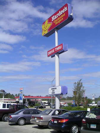 I couldn't believe my eyes in southern Mississippi.  A $250 hiring bonus for Hardees!!  Click on the pic to enlarge.  It's the black and white sign near the bottom of the pole.
