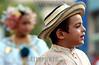 """Panama - Panama City: nino con un sombrero de paja . El """"desfile de las Mil Polleras"""" es tradional en la Ciudad de Panama, y en el participan los principales grupos culturales y etnicos del pais. La Polleras son el traje tipico de la mujer en Panama.  / Panama: Parade of the one thousan Polleras is traditional of Panama City and in it, he main cultural and etnic groups of Panama take parts in it.  The Polleras are the titpical female dress of Panama. Panama's folklore is fully expressed in its traditional dances, its colorful """"Pollera"""". / Panama: Frauen tragen die Nationatracht Pollera. Folklore.  © Tito Herrera/LATINPHOTO.org"""