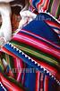 Bolivia: Bebe durmiendo en Isla del Sol . manta de lana. trabajo hecho a mano. colorar. / Bolivia: Sleeping Baby. / Bolivien: Schlafendes Kleinkind eingehüllt in eine farbige Decke. Webkunst. Farben.  © Dario Diament/LATINPHOTO.org
