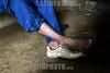 Guatemala: Anciano se coloca sus zapatos, es tanta la<br /> pobreza que utiliza una bota y un tenis, esto es comun<br /> en la aldea Xexocom, nebaj departamento de Quiche . / Guatemala: feet. poverty.  / Guatemala: Füsse eines Mannes aus Xexocom.  © Esbin Garcia/LATINPHOTO.org