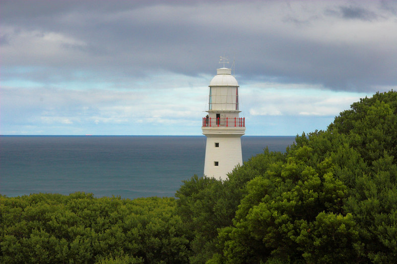This is the Cape Otway lighthouse. It was constructed in 1846-8, and was the second lighthouse built in Australia. For many people travelling from the UK to Australia, Cape Otway was the first land they sighted after leaving Britain, in a journey that could take five months.<br /> <br /> The lighthouse is enormously expensive. As well as costly mirrors, lenses and lighting mechanisms, it all rotates on a pool of mecury that's worth millions of dollars. In 1962 there was an earthquake at Cape Otway (truly!), and a lot of the mercury spilled out down the steps. So, since the pool was now lower, they lightned the weight of the light by removing some of the lenses: and hence didn't have to spend millions replacing the lost mercury.