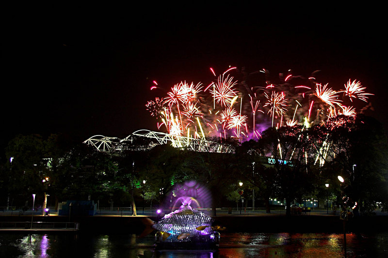 Fireworks above the MCG (with the Rod Laver Arena and the Yarra River in the foreground).