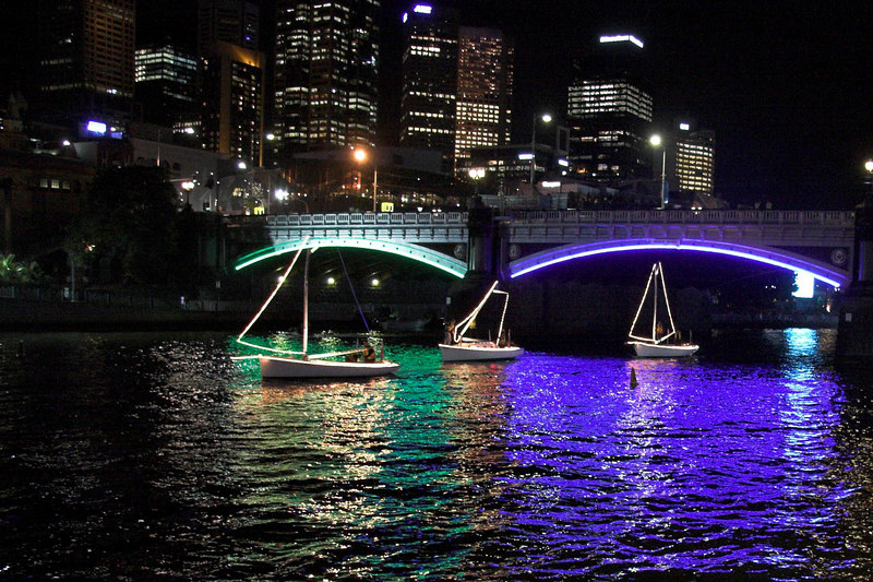 """After the ceremony, all the boats that had travelled up the Yarra needed to return. Here are three of the """"Sail Boats"""" returning down the Yarra. The middle boat has already started taking down its (fake) mast so that it can fit under the lower bridges further down the river."""