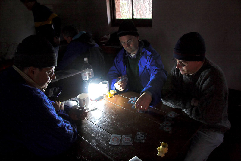 Dennis, Dale and David playing bridge in the Stone Hut: whilst it rained outside.
