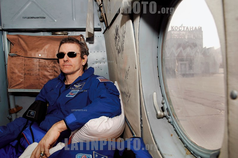 Astronaut William S . McArthur, Jr., NASA Expedition 12 commander, waits onboard a helicopter before transferring to an airplane for a flight back to Moscow from Kustanay, Kazakhstan. The Expedition 12 crew and astronaut Marcos Pontes, Brazilian Space Agency participant, returned to earth on the Soyuz TMA-  7 spacecraft and landed in the steppes of Kazakhstan on April 8, 2006, at 7 :48 p.m. EDT. Returning on the spacecraft along with McArthur and Pontes was cosmonaut Valery I. Tokarev, Russia's Federal Space Agency flight engineer and Soyuz commander. Pontes arrived at the station with the Expedition 13 crew on April 1. © NASA/Bill Ingalls/LATINPHOTO.org