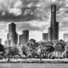 A view towards the skyline of Melbourne from the south eastern corner of Albert Park Lake.<br /> <br /> Technical explanation behind the image: Three images with -2, 0 and +2 exposure combined as a High Dynamic Range image to provide details in clouds, trees and buildings. Converted to black & white with a red filter (to accentuate the clouds and lighten the trees). Clarify tool used. Noise added to 'roughen' the image.