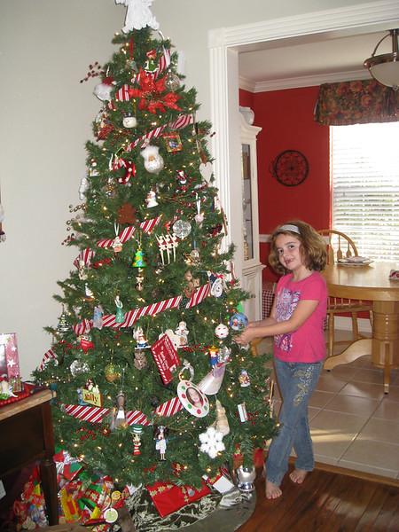 Sabrina adds an ornament