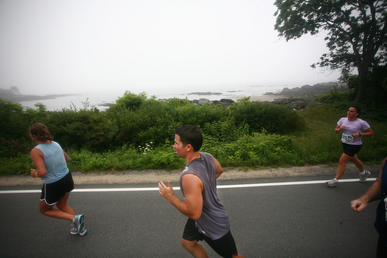 Lincoln Benedict/SunJournal<br /> At around mile four runners hit Shore Road which leads to some spectacular views over the bay- though most are locking down their paces to finish strong.