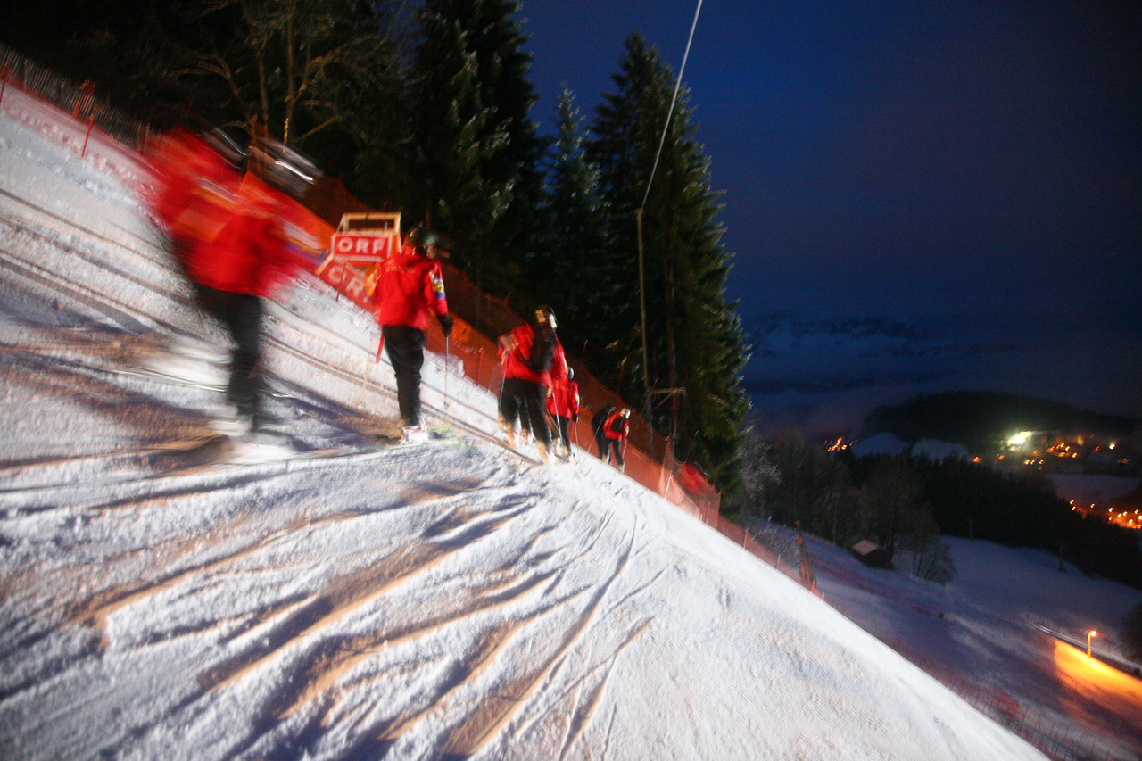Lincoln Benedict for Ski Racing<br /> Workers slip the famous Hahnenkamm course before dawn at  Kitzbühel, Austria to clear it of the new fallen snow from the night for the Super-G race that day.
