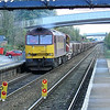 60065 is seen waiting to Depart from Hessle Station with 7T69 1130 Hessle Station - Healey Mills Yard spoil train in the distance a UID 66 can be seen with empty coal fish wagons.