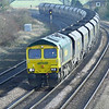 One of Freightliner's low emission class 66598 is seen rushing towards Knabbs Bridge with 6R10 1035 Immingham H.I.T. - Ferrybridge P.S. loaded coal working.