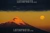 Chile: Volcan Osorno al anochecer , visto desde la ciudad de Puerto Varas en luna llena . Elejido popularmente como el volcan mas hermoso del mundo, en sus laderas se encuentra un centro de ski donde en invierno se pueden practicar muchos deportes extremos al igual que en verano. luna. / Volcan Osorno is a 2,652 m (8,701 feet) tall conical stratovolcano lying between the provinces of Osorno and Llanquihue, in Los Lagos Region of Chile. It stands on the southeastern shore of Lake Llanquihue, and also towers over Todos los Santos Lake. / Der Osorno ist ein 2.652 m hoher Vulkan in Südchile. Er liegt in der Region de los Lagos (Region X) einige Kilometer östlich des Llanquihue-See und besteht aus 18 erloschenen kleinen Kratern und gilt als kleiner Berg Fuji Chiles. Der Osorno ist eines der beliebtesten Touristenziele Chiles. Mond. © Francisco Negroni/LATINPHOTO.org
