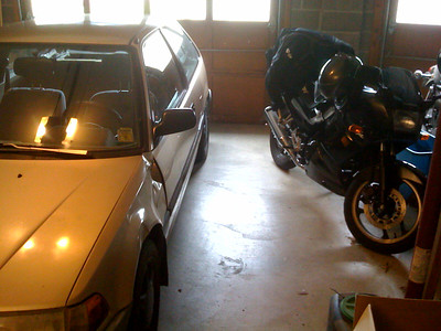 """As the weather warms, my car has transitioned back to the role of """"Obstacle while backing the motorcycle out of the garage"""""""