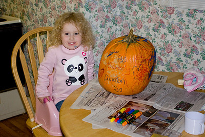 Beverly decorates the pumpkin