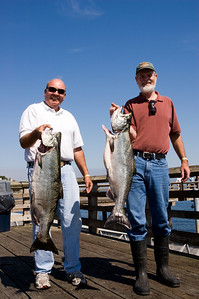 Two fisherman with their salmon. The one on the left is the 27.1 pounder that won the derby.