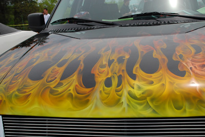 I don't know if the flames on this Explorer were painted or decaled, but they were incredible.  2009 Magic Dragon car show Lake of the Ozarks (c) D.L.Jones Photography 2009