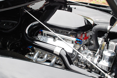 Engine in slick black F-100 pickup.  2009 Magic Dragon car show Lake of the Ozarks (c) D.L.Jones Photography 2009