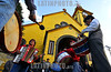 Chile - Calbuco : Muy temprano y de todos los rincones del Archipielago de Calbuco, comienzan a llegar cientos de peregrinos a la Iglesia de esta ciudad, es solo una vez al ano que pueden reunirse con su Patrono San Miguel Arcangel . La Tradicion pide que cada delegacion de peregrinos traiga sus santos, es asi como se re˙nen mas de 30 figuras dentro de la iglesia. Cada figura viene acompanada de un fiscal, persona elegida que representa a una delegacion y es la encargada de llevar el rito de saludo de banderas y encabezar la procesion de su figura en un desfile increible de imagenes por las calles de la ciudad. Todo comienza con la llegada de los Santos y el saludo de banderas al exterior de la iglesia, despues de esto se puede ingresar y colocar la imagen en un lugar determinado para su adoracion dentro del templo, todo continua con la misa y terminando con la Procesion mayor al atardecer, a la cual asiste toda la comunidad y que es acompanada de bandas con bombos y cajas mas rezos de los presentes. / Pilger in Calbuco. Prozession. Katholiken. Religöses Fest . © Francisco Negroni/LATINPHOTO.org