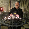 Neal teasing Erik's friend David, a Notre Dame fan, by lighting a candle in the real Notre Dame, Paris