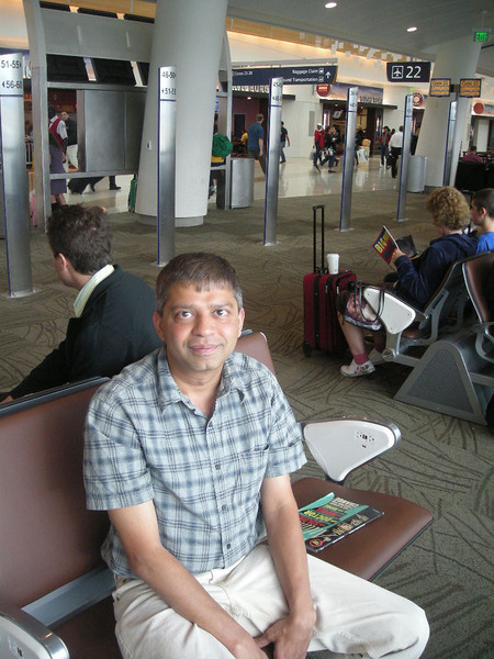 Raja Aji in San Jose airport waiting for our flight on Friday, Oct 22, 2010.