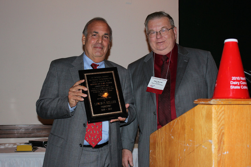 Butch Miller, Queensboro Farms, Jamaica Queens accepts a plaque of recognition for his years of service 2002-2010 as President of Northeast Dairy Foods Association, Inc. from Jim Buelow (Right) incoming President