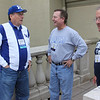 Larry Webster, left talks business during the Tailgate Party