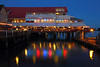 Fisherman's Wharf at Steveston. Neon lights from the Charthouse Restaurant feflect off the water.<br /> Richmond, British Columbia, Canada
